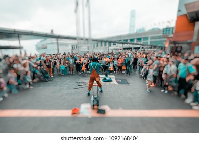 Blur out of focus background of street talent show in public place with a lot of audiences excite and enjoy the show