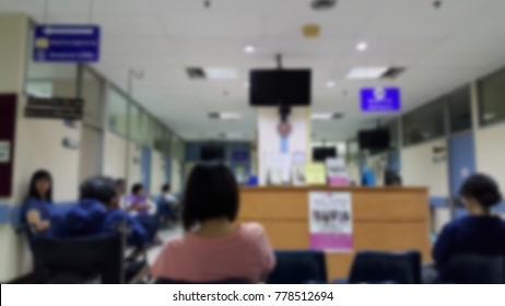 Blur of outpatients and family sitting to meet a doctor as their medical appointment on weekday at examination room in the public hospital, Thailand. Waiting to meet a doctor concept.