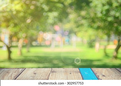 Blur park with nature green bokeh on wood abstract background.
