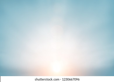 The blur pastels gradient sunset background on soft nature sunrise peaceful morning beach outdoor. heavenly mind view at a resort deck touching sunshine, sky summer clouds.