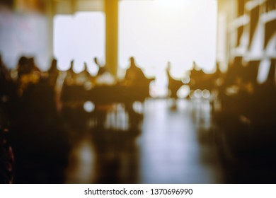 blur of people in coffee shop background