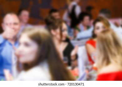 Blur people eating and talking in dining room, restaurant party celebration concept