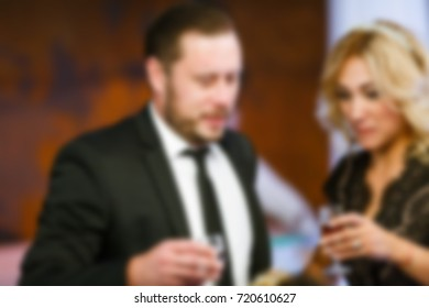 Blur people eating and talking in dining room, restaurant party celebration concept.