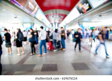 Blur people on electric sky train station for passenger in city, urban lifestyle