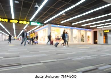 Blur people walking in airport blur
