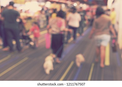 blur people walking dogs at dog shows - blurred background concept