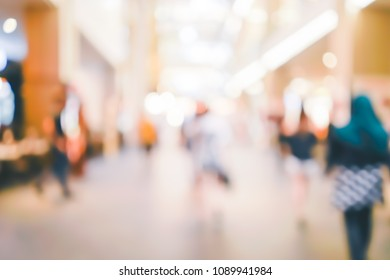 Blur people walking in shopping center mall abstract background. Copy space of business travel concept. Retro tone filter color style.