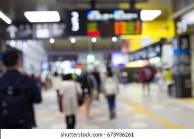 Blur of people walking in train station, Japan
