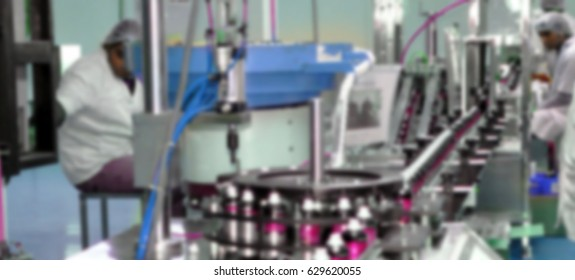 Blur pharmaceutical industry. Production line machine conveyor with filling tin spray can
