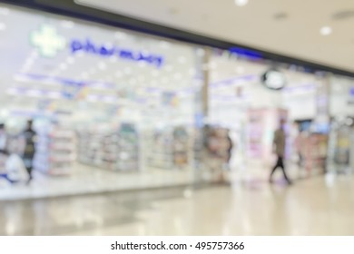 Blur pharmacy shop or retail drug store interior background with pharmaceutical, cosmetic and medicine supplies on shelves
