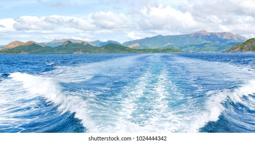 blur  in  philippines   a view from  boat  and the pacific ocean  mountain background