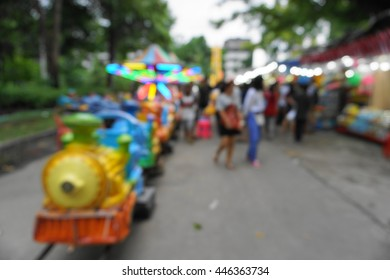 blur photo of asian local canival fun fair in evening time on cloudy day