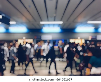 blur photo of Asian people on the queue line on rush hour waiting for train subway station. Stay in the crowd cause stress in everyday life and jeopardize people health.