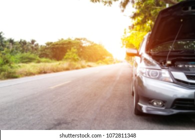 Blur photo of car is broken on the Road to Asphalt in countryside help concept
