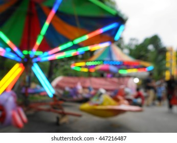 blur photo of local charity canival fun fair in evening on cloudy day