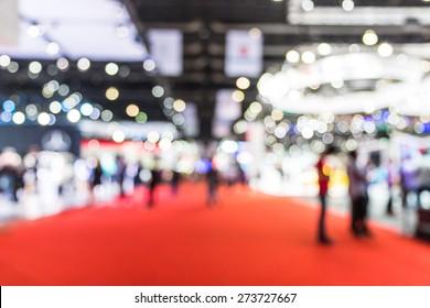 blur photo of motor show, car show room