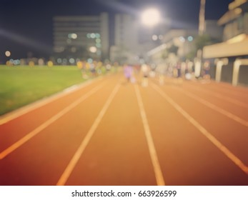 blur photo of racetrack in night time
