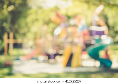 Blur playground in park abstract background. Film tone effect.