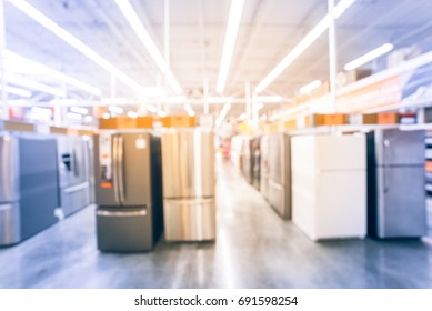 Blur retail store, row of home appliances equipments. Defocused brand new wide selection of French door refrigerators with ice makers. Row of stainless steel fridge, price tag on display. Vintage tone