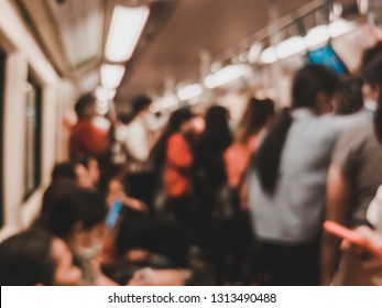 Blur scene of crowd of people cram into a metro train during the evening rush hour in Bangkok, Thailand
