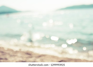 Blur sea nature  tropical beach with bokeh sun light wave  background. Copy space of summer vacation travel concept in Vintage color