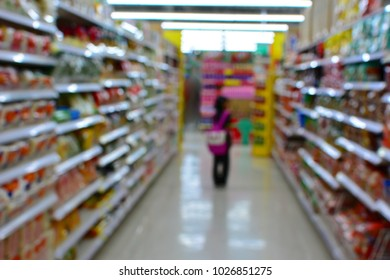 Blur shopping mall or supermarket interior with lonely child girl.