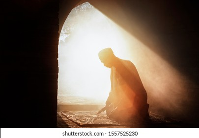 Blur Silhouette , Muslim priest praying at the mosque.
