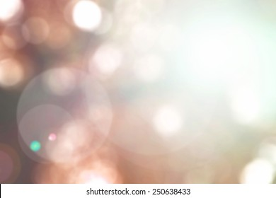 Blur sky background with nature glowing sun light flare and bokeh in vintage red orange brown color
