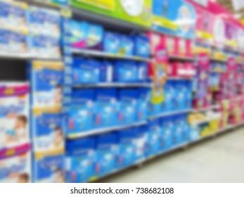 Blur, Soft-Focus - Sanitary napkins on shelf in supermarket