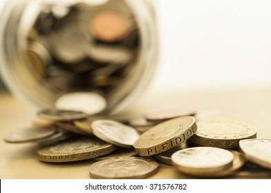 Blur stack of coins background money saving concept