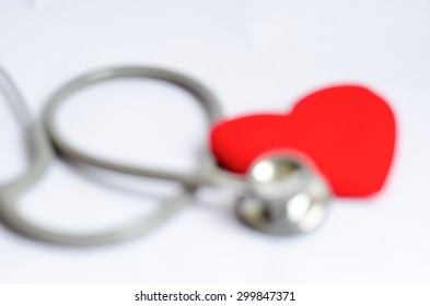 Blur Stethoscope with red heart background - Health care concept