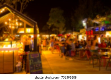 Blur street outdoor night food and beer space for relax chill out and hang out and listen to music for background