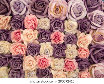 Blur style photo of the paper beautiful roses background for decorate the wedding ceremony.