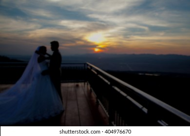 Blur style wedding couple. Backdrop of the  sunset