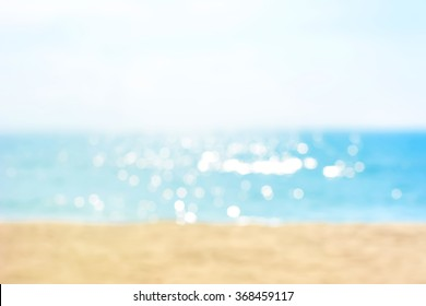 Blur summer white sand beach with sparkling sea water
