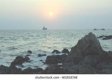 blur sunset background sea and stone with Pale&Light color tone