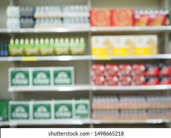 Blur Supermarket sale liquor, whisky or Alcohol drink section on shelves background, Many Alcohol drink bottles sale on the shelf in a supermarket, as blurred effect background, Alcohol drink section.