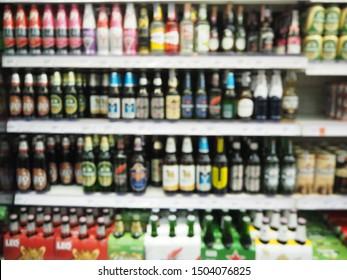 Blur supermarket sale liquor, Whisky or Alcohol drink Section on shelve background, Many Alcohol drink bottles sale on the shelf in supermarket, as blurred effect background, Alcohol drink section.