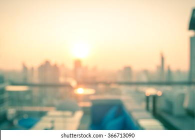 Blur terrace rooftop view of city autumn sunset background