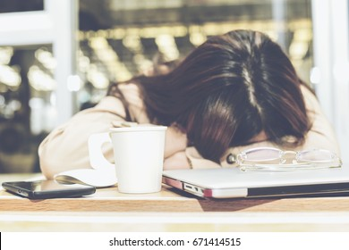 Blur of Tired office worker woman sleeping right on her laptop's keyboard