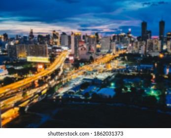 Blur traffic jam on road in city life town with light luminosity nightlife for abstract background concept