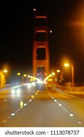Blur traffic on Golden Gate Bridge at night, The Presidio, San Francisco, California, USA
