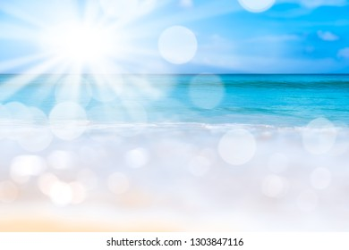 Blur tropical beach with bokeh sun light wave on blue sky and white cloud abstract background. Copy space outdoor summer vacation and travel adventure concept. Vintage tone filter effect color style.