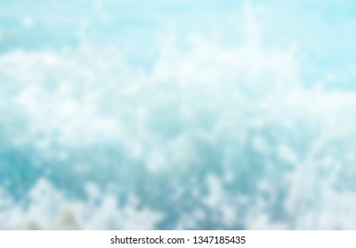 Blur tropical beach with bokeh sun light wave abstract background, Travel concept