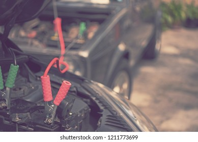 blur using jumper cable to recharge a flat battery - blurred background concept