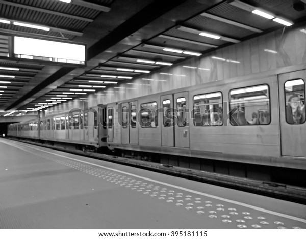 Blur view of Brussels metro platform in Bru.-Luxemburg/brux.-Luxembourg station.(Black and white represent RIP)