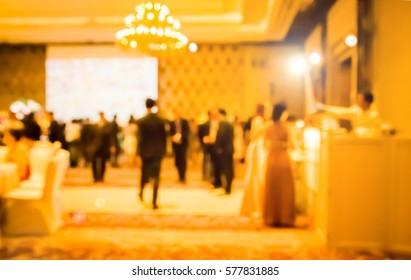 blur waiter on gala dinner service in hotel ballroom