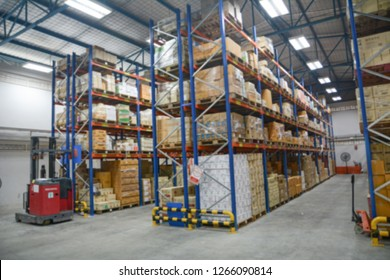 Blur Warehouse inventory product stock for logistic background, Long shelves with a variety of boxes