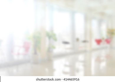 Blur white living room background with warm light.