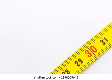blur yellow tape measure in the white light like concept of diet and lenght tool and copy space